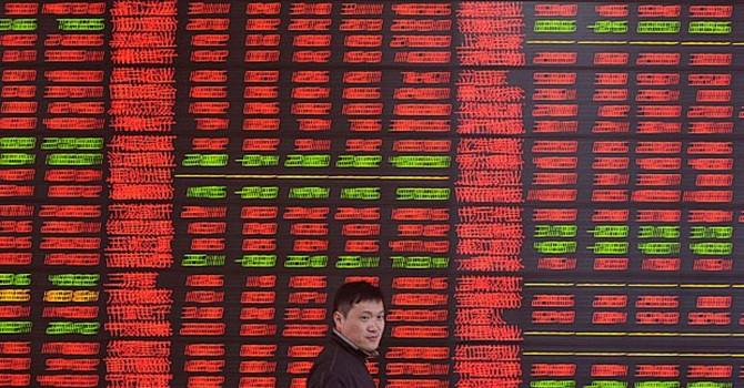 """Trung Quốc: Máy tính """"chết cứng"""" vì giao dịch chứng khoán tăng kỉ lục"""
