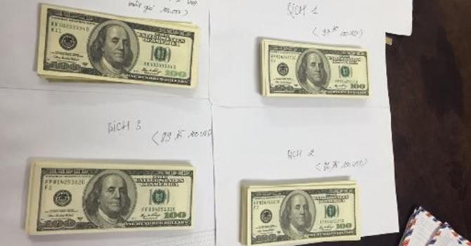 Mua 3 bịch USD giả từ Campuchia về TP. HCM tiêu thụ